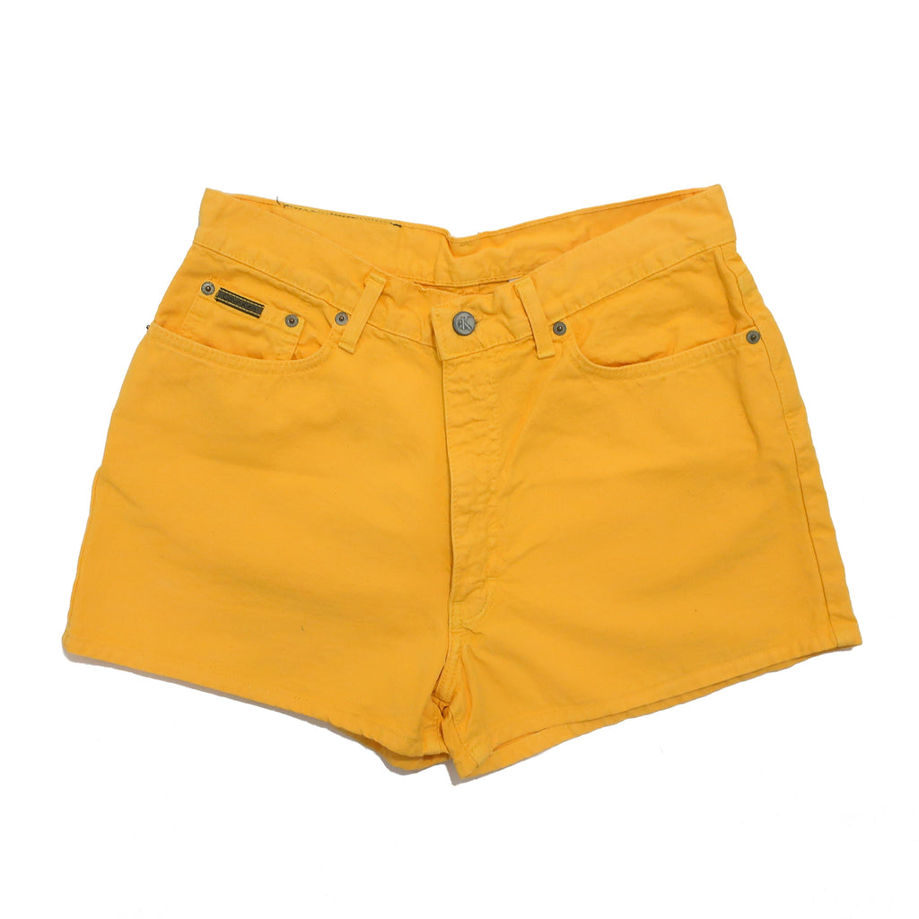 "Second Room Vintage Clothing. 90s vintage yellow Calvin Klein Jeans denim shorts, 5 pocket style, with 11.5"" rise. These have a CK branded top button with zipper fly, belt loops and leather Calvin Klein Jeans back patch. Free North American shipping on all orders."