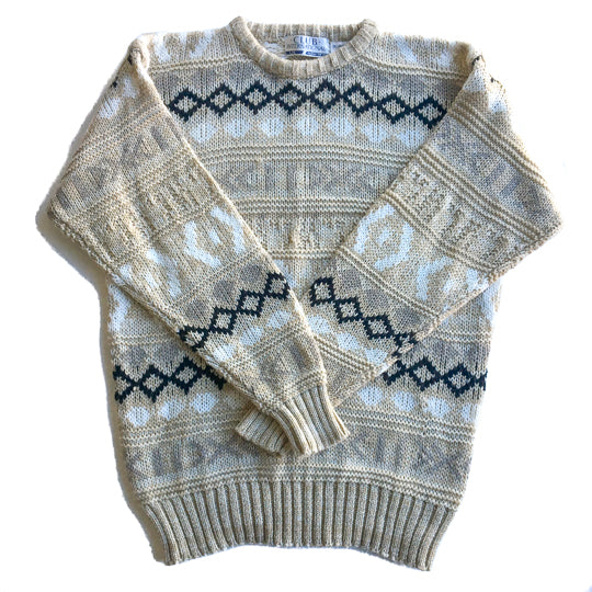 Second Room Shop Vintage. Shop vintage, shop sustainable. Vintage beige crewneck sweater with white, grey and black geometric pattern. This is a men's size large, and would look great as an oversize fit.