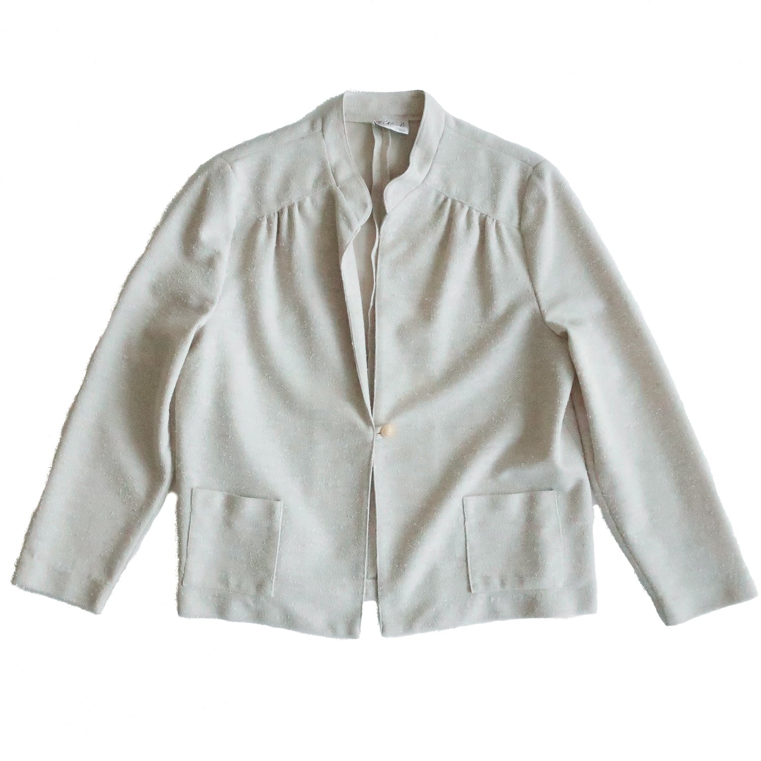 Second Room Vintage Clothing. Vintage oatmeal coloured textured fabric jacket, with small standing collar, one button closure and two front patch pockets. Free Shipping on all orders within North America.