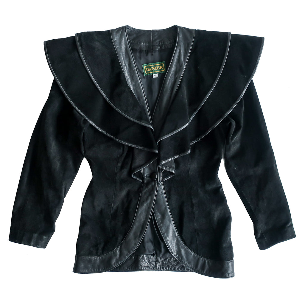 Second Room Vintage Clothing. Vintage, very unique Danier black suede and leather jacket, from the 80s. This jacket has a really interesting silhouette with a double layered, ruffle detail at the shoulder. Free North American shipping on all orders.