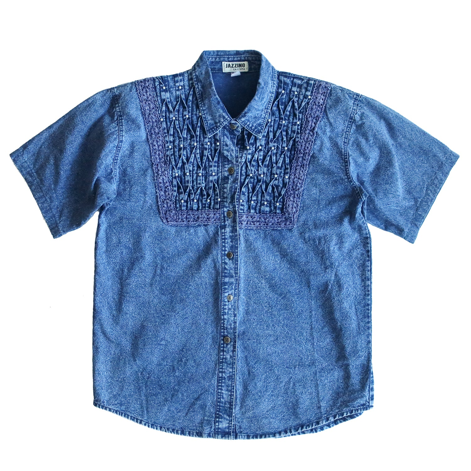 Second Room Shop Vintage. Shop Vintage, Shop Sustainable. Vintage denim shirt with slight acid washed finish, and details on the front with gathered/pleated denim, and sewn on pearl beads. This shirt has shoulder pads which could be easily removed.