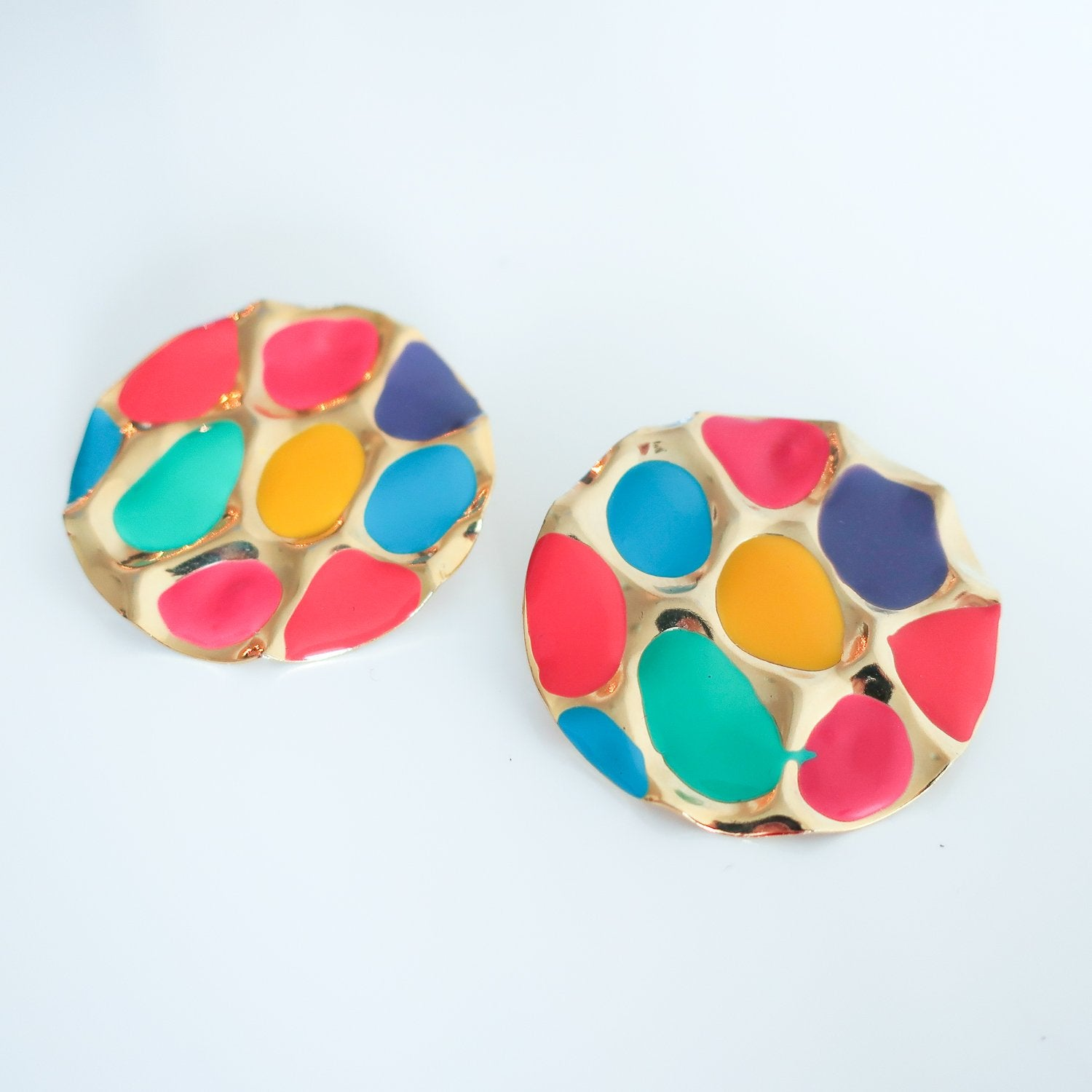 "Second Room Vintage Clothing. Vintage gold tone round pierced studs, with dimpled design, and colourful painted enamel insets in yellow, pink, orange, green, purple and blue. Earrings are 1.5"" wide. Original earring backs have been replaced with new, clear silicone backings. Free North American shipping on all orders."