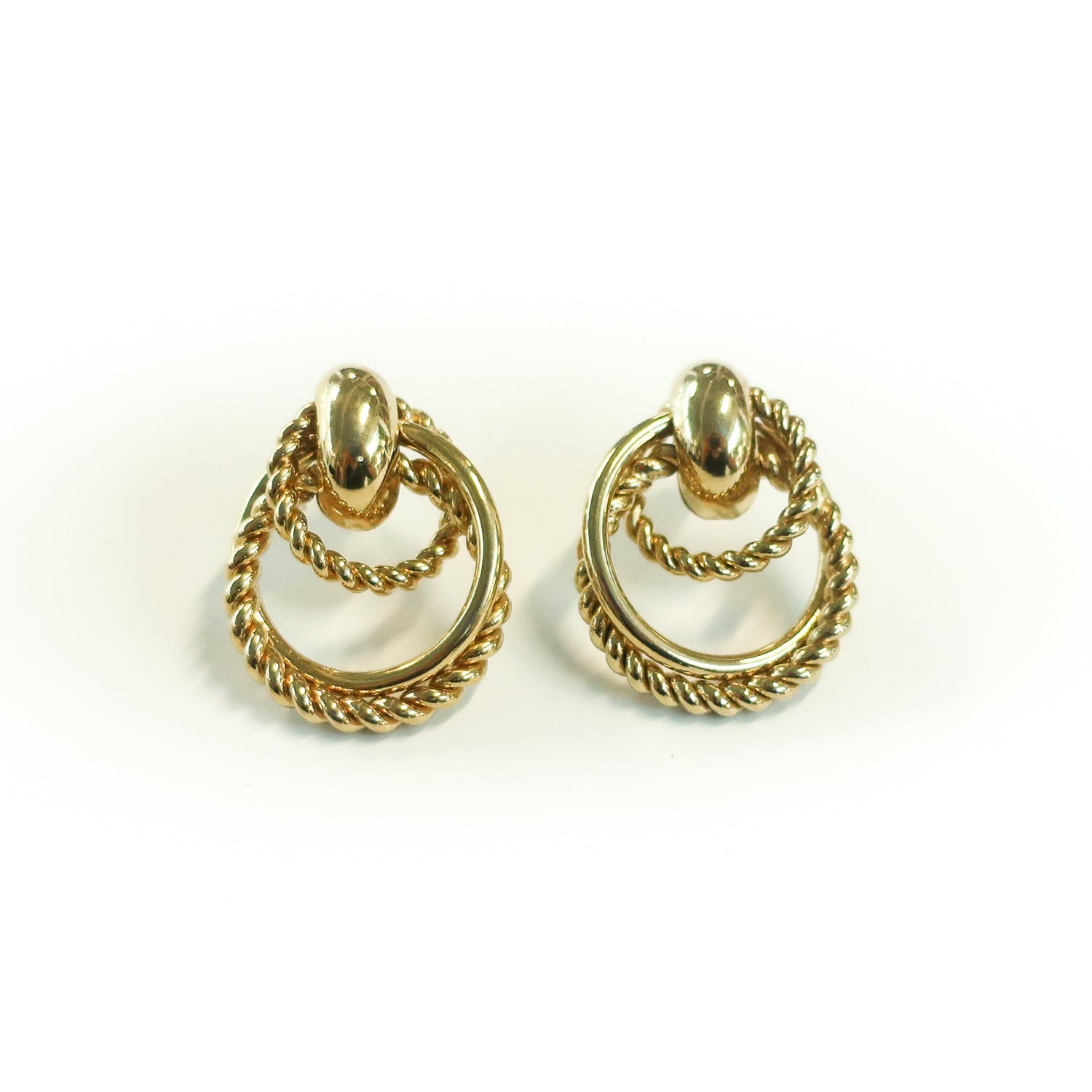 "Second Room Vintage Clothing. Vintage gold tone twisted rope door knocker style earrings, 7/8"" across and 1.25"" long. Original earring backs have been replaced with new, clear silicone earring backs. Free North American shipping on all orders."