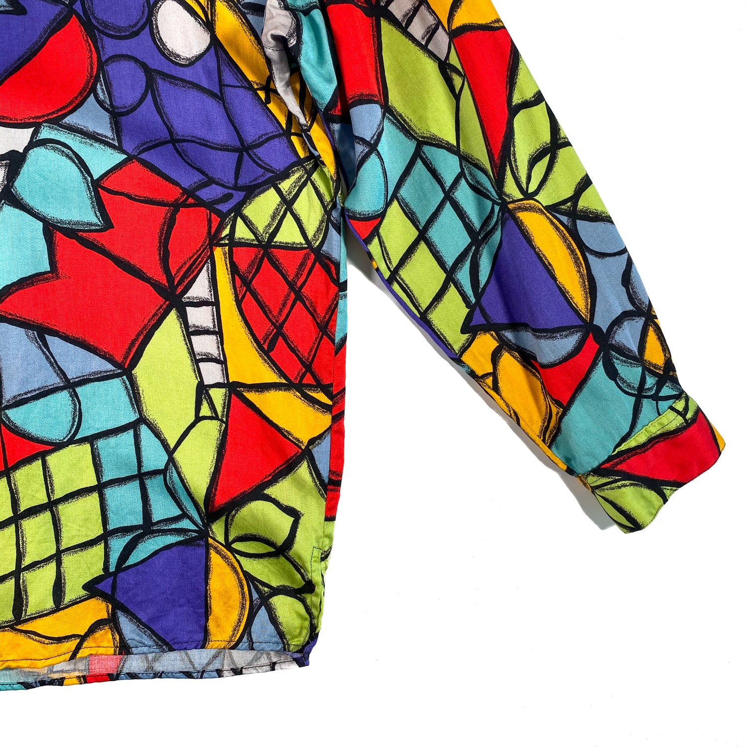 Second Room Vintage Clothing. Vintage 90s Esprit long sleeve blouse, with abstract print in orange, lime green, red, purple, grey and black. Top button does up with a loop, and the buttons down the front are hidden behind a placket. Free Shipping on all orders within North America.