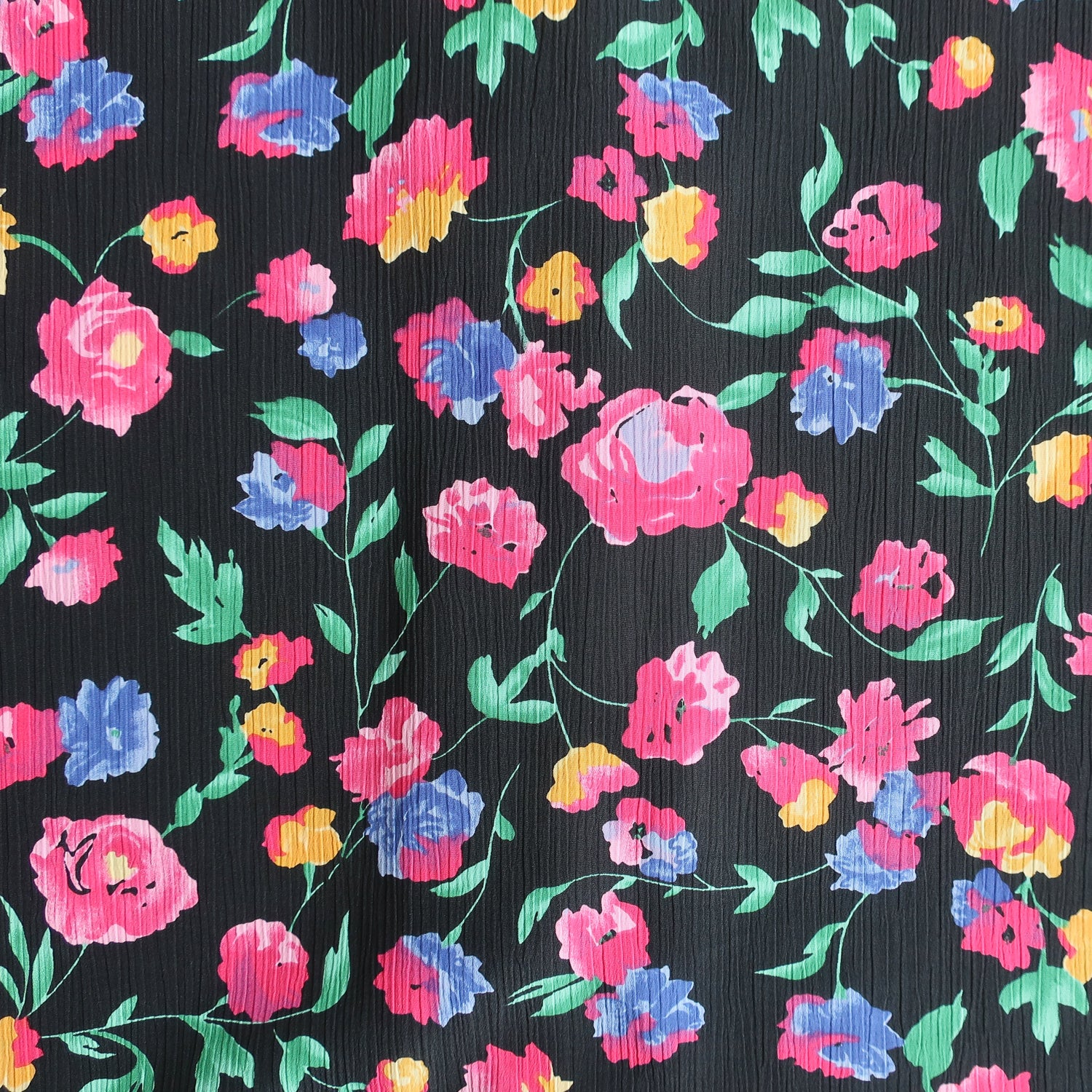 Second Room Vintage Clothing. Vintage short sleeve button up blouse with floral print in pink, yellow, blue, green and purple on black. Free Shipping on all orders within North America.
