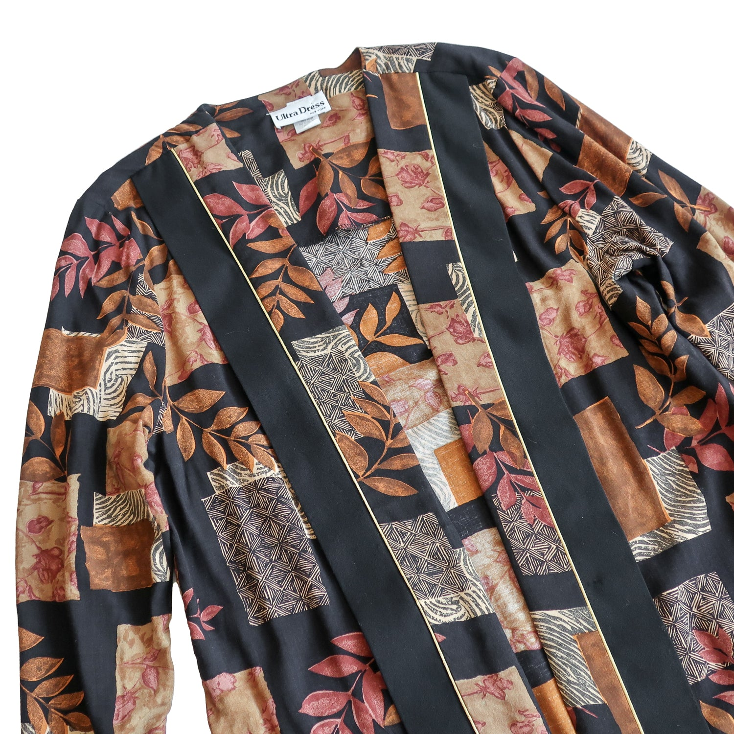 Second Room Vintage Clothing. Vintage open cardigan with no buttons or closures, with fall leaves print in brown, orange and black, and gold piping trim. Rolled cuffs, not lined, and very light weight. Free North American shipping on all orders.