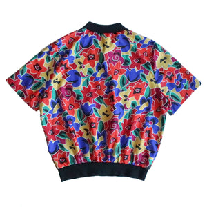 Second Room Vintage Clothing. Vintage short sleeve button up pull over blouse, with bright graphic floral print in orange, yellow, green, pink, and blue. Free Shipping on all orders within North America.