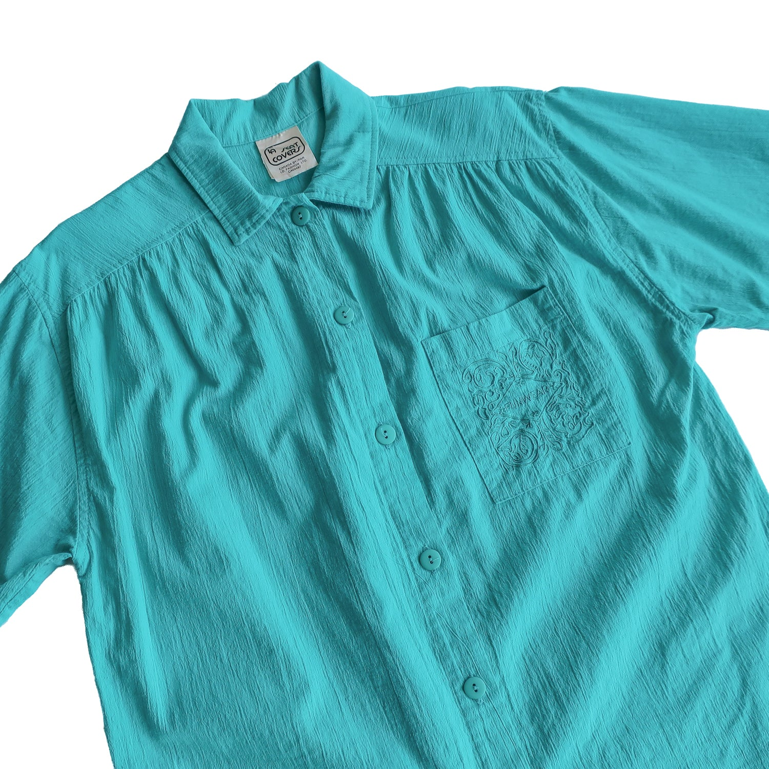 "Second Room Vintage Clothing. Vintage turquoise green button up shirt, with one breast pocket with ""FUNWEAR"" embroidered on it. Free Shipping on all orders within North America."