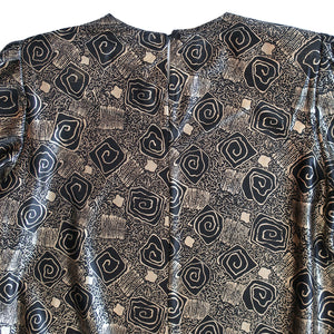 "Second Room Vintage Clothing. Vintage black and gold lamé, abstract rose print long sleeve blouse, with crew neck, one button closure at back of neck, and mid length sleeves (17"" long). Free North American shipping on all orders."