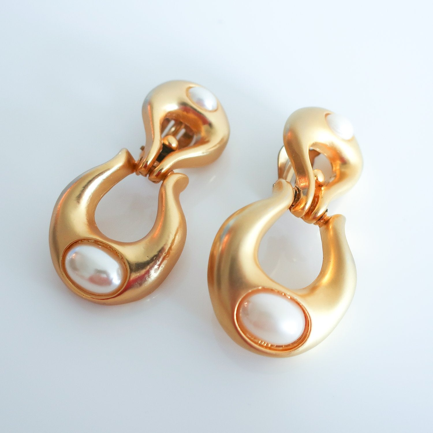 "Second Room Vintage Clothing. Make a statement with these rad matte finish gold tone and faux pearl door knocker style, clip on earrings. These are 2.25"" long and 1.25"" at the widest part. Free North American shipping on all orders."