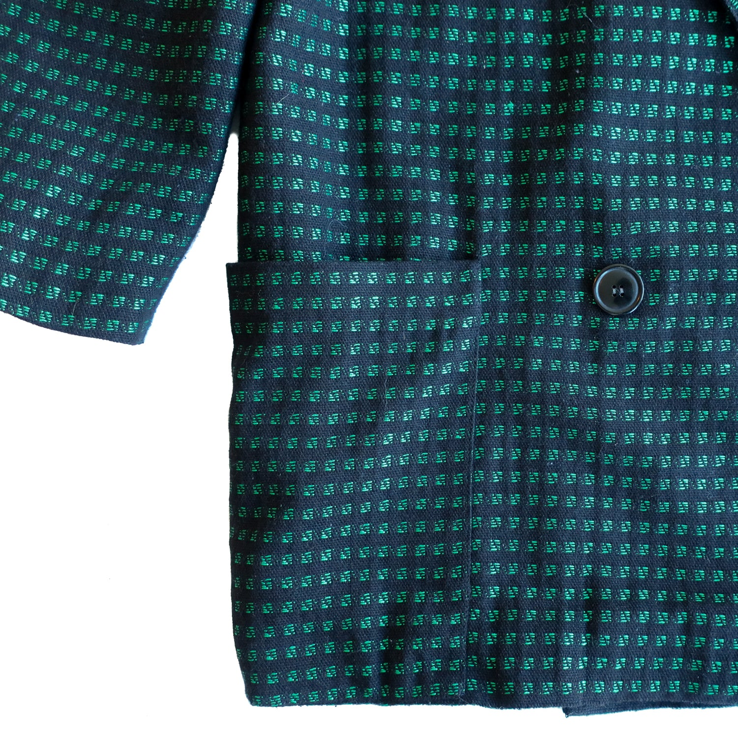 Second Room Vintage Clothing. Vintage double breasted black blazer with bright green square pattern. Fully lined in black, with two front pockets that wrap slightly around the sides to the back. Subtle sewn in shoulder pads and black buttons. Free North American shipping on all orders.