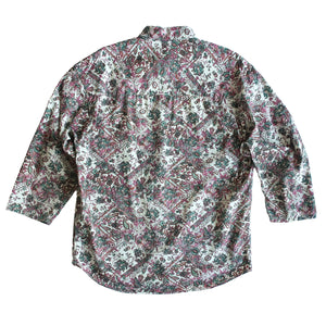 Second Room Shop Vintage. Shop vintage, shop sustainable. Vintage 90s Guess shirt with a paisley style western print, in pink, green and ivory. Long sleeves with no cuff, and one front pocket with the Guess logo.