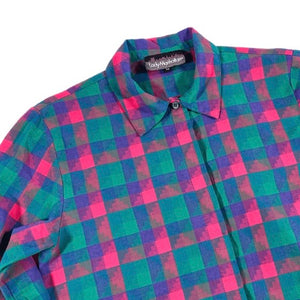 Second Room Vintage Clothing. This vintage blouse is super soft and feels almost like flannel. It has a geometric plaid print in pink and green. Covered button placket, and one button at each sleeve. Free Shipping on all orders within North America.