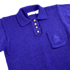 "Second Room Vintage Clothing. Vintage deep purple short sleeve, pull over sweater, with four gold buttons at the collar. Has one breast pocket with nautical style embroidery. Sleeve is 9"" long from under the arm. Free Shipping on all orders within North America."