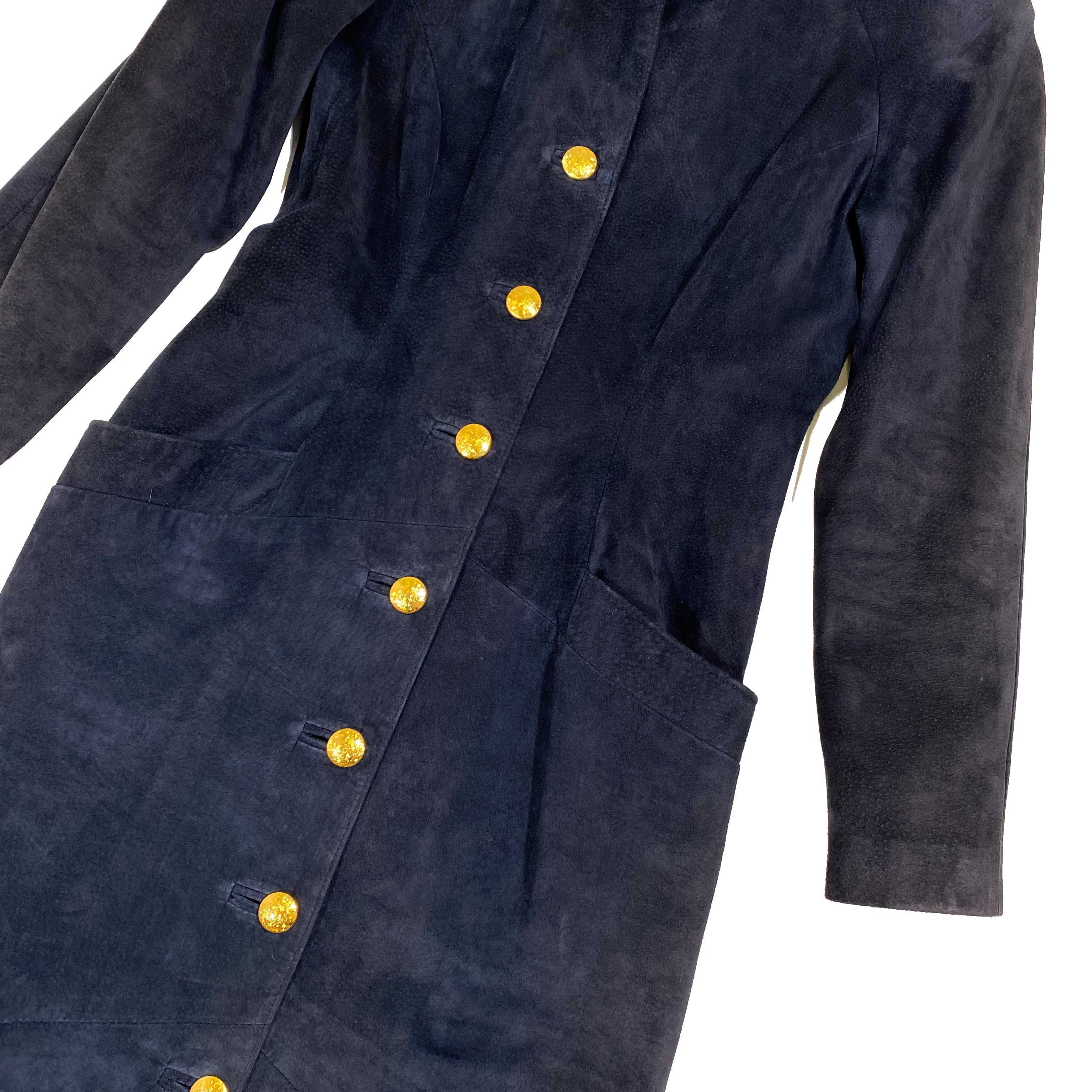 Second Room Vintage Clothing. Vintage navy blue Danier suede long coat, with rounded dolman sleeves, and shoulder pads. Fully lined, fitted silhouette, two front pockets and gorgeous gold tone buttons. Free Shipping on all orders within North America.