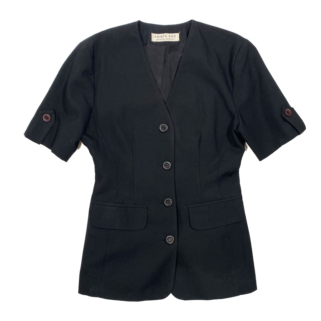 Second Room Vintage Clothing. Vintage black short sleeve fitted blazer, with button front, and cute tab and button details on the sleeves. Fully lined, with two front pockets and no shoulder pads. Free North American shipping on all orders.