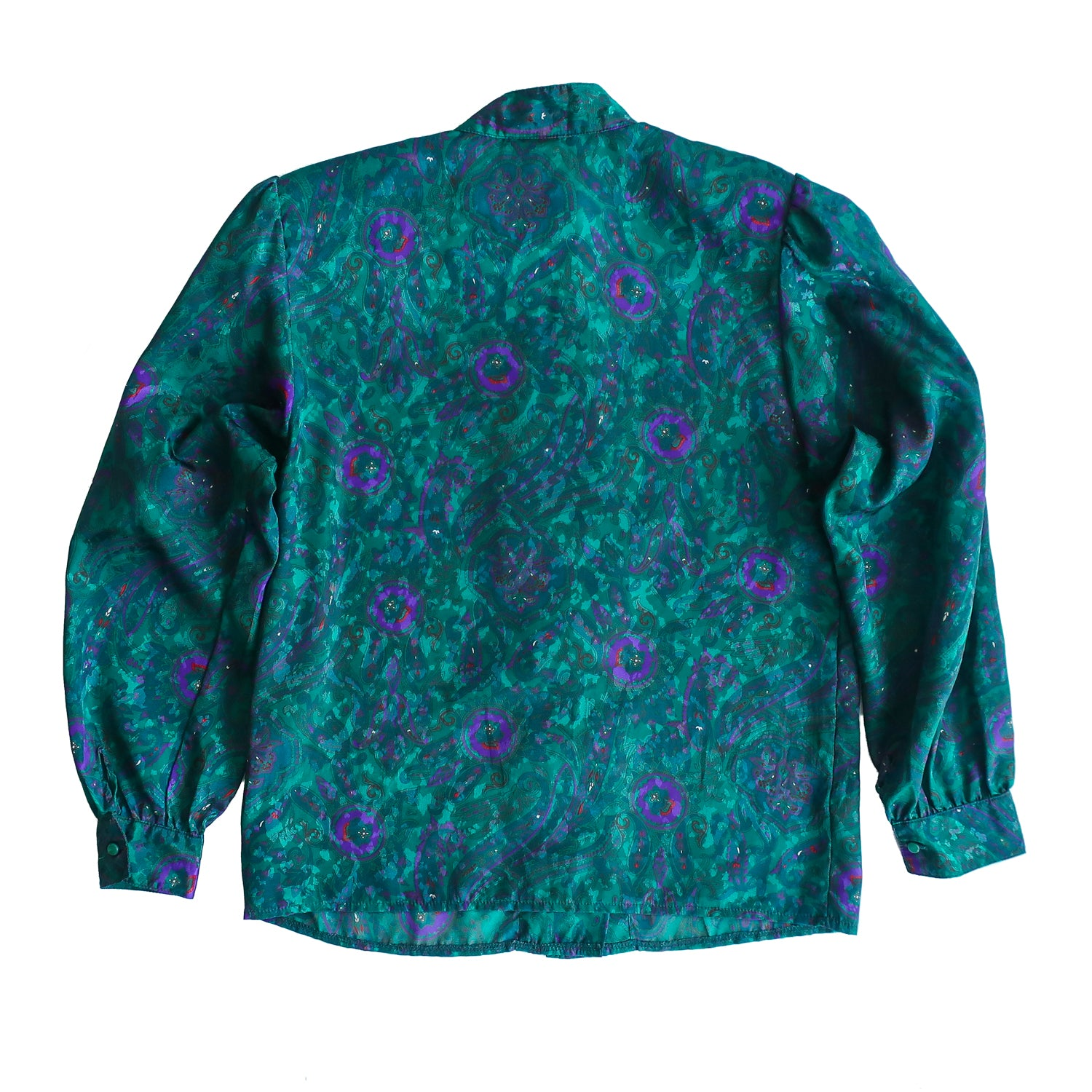 Second Room Shop Vintage. Shop vintage, shop sustainable. Vintage long sleeve blouse with a gorgeous paisley print, in emerald green, blue and purple. This blouse buttons down the front, with a double button style, and has a standing collar. The shoulders have a slightly gathered detail, with one button at each cuff, and there are shoulder pads that can be easily removed.