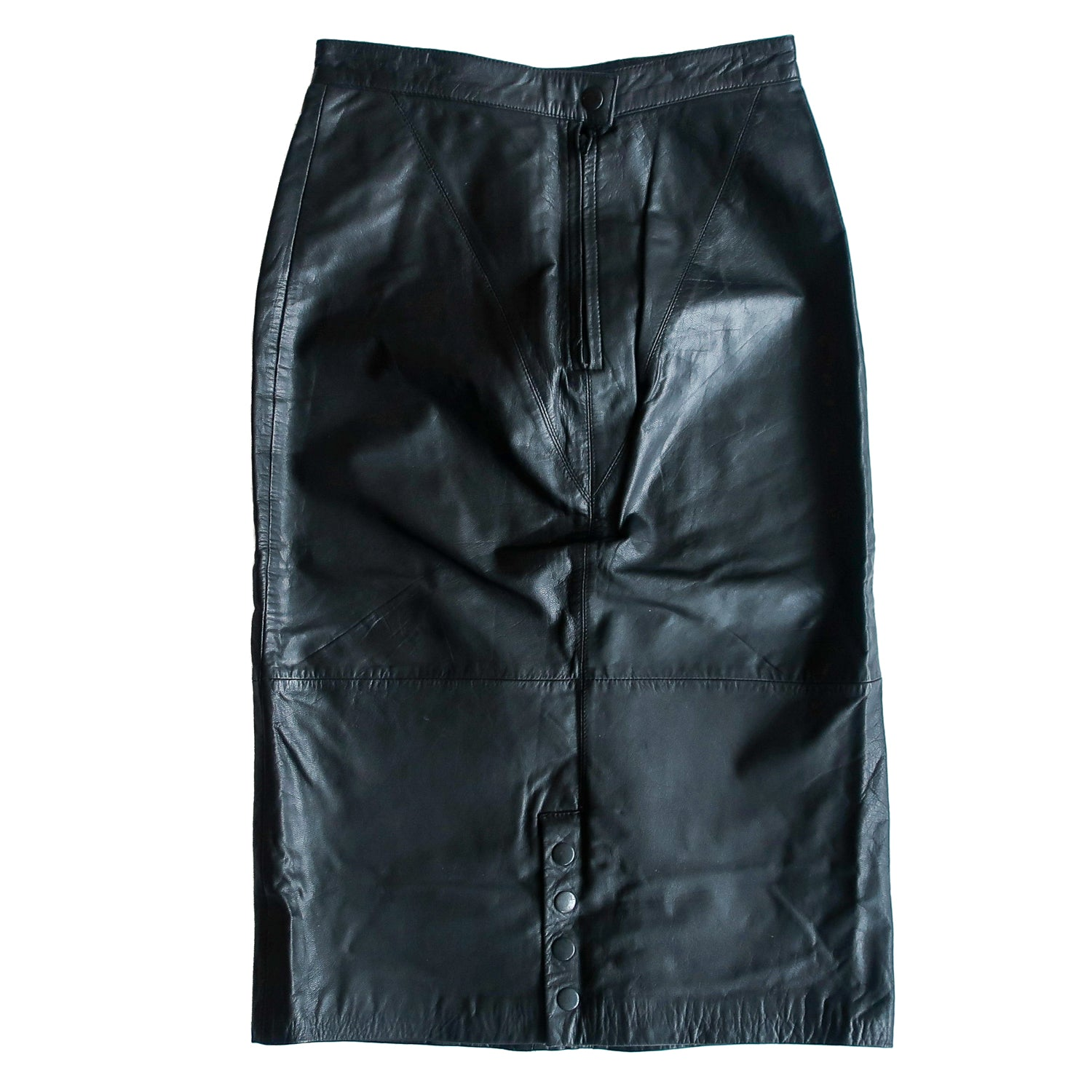 Second Room Shop Vintage. Shop vintage, shop sustainable. Vintage high waisted black leather midi skirt, with dart seam details, zipper and snap closure at back. Fully lined, with 4 snaps at the back slit that can be opened, or kept closed.