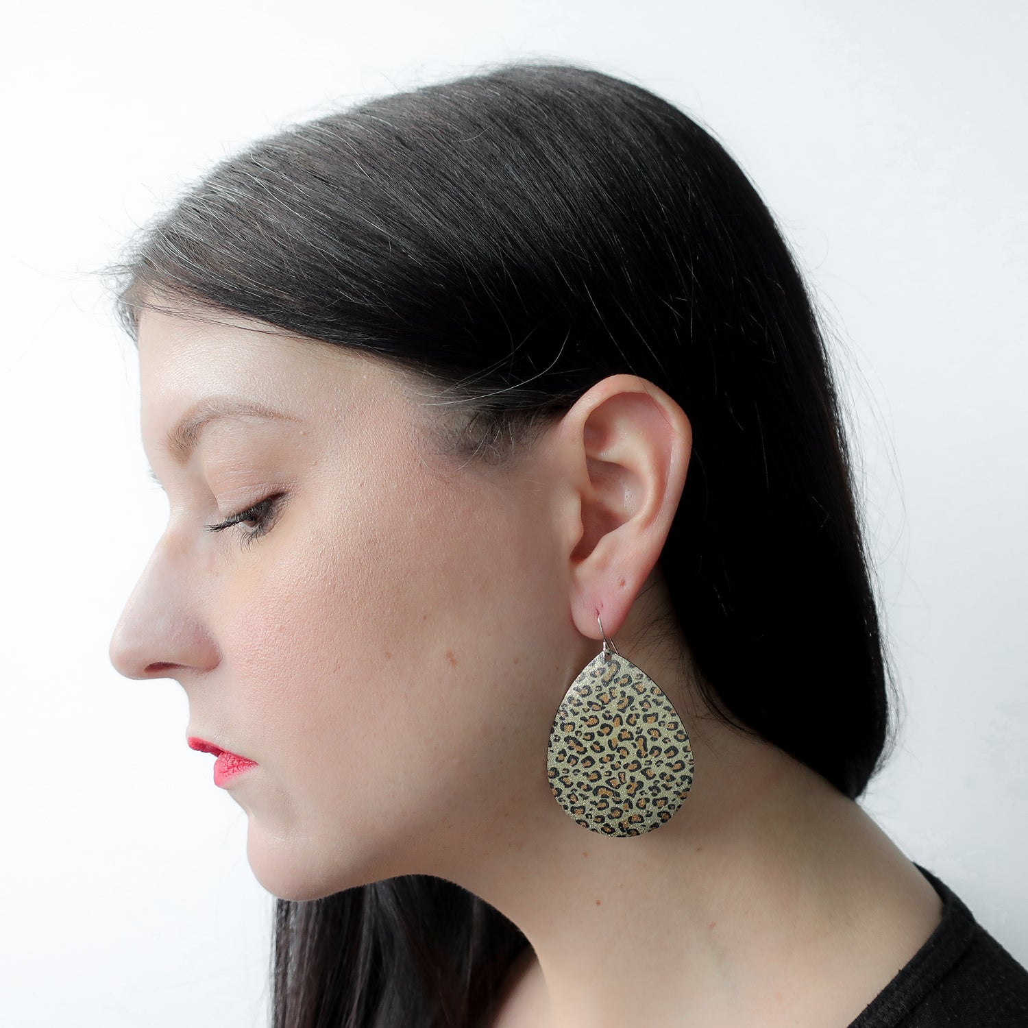 "Second Room Shop Vintage. Shop vintage, shop sustainable. Vintage metal, leopard print teardrop earrings, 2"" long, 1.5"" wide. Original earring backs have been replaced with new, clear silicone earring backs."