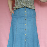 Second Room Vintage Clothing. Vintage button front denim A-line midi skirt, with two side pockets and belt loops. Free North American shipping on all orders.