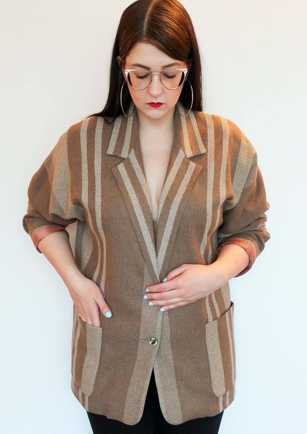 Second Room Vintage Clothing. Vintage brown and beige wool blend, herringbone striped blazer, with dolman sleeves, two front pockets, and one button closure. Blazer is fully lined and has a great oversize fit. Free North American shipping on all orders.