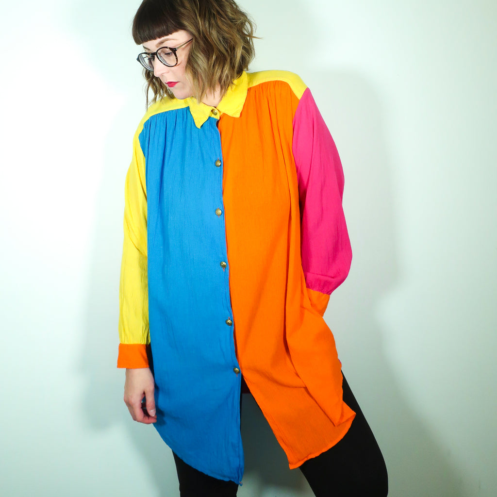 Second Room Vintage Clothing. Vintage color block blouse that is long enough to wear as a tunic/dress. Made from 100% cotton, with a gauzey texture, gold buttons, and shoulder pads that could be easily removed if desired. Free Shipping on all orders within North America.