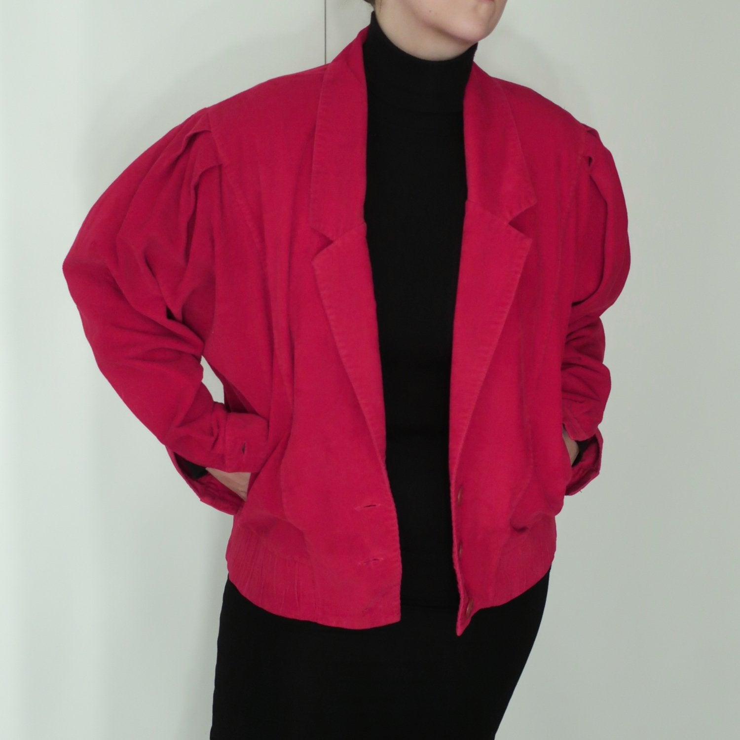 Second Room Vintage Clothing. Vintage cranberry corduroy jacket, with 3 button closure, two front pockets, and dolman sleeves with pleating details at the shoulders. No shoulder pads, one button on each cuff, and an elastic waist. Free North American shipping on all orders.
