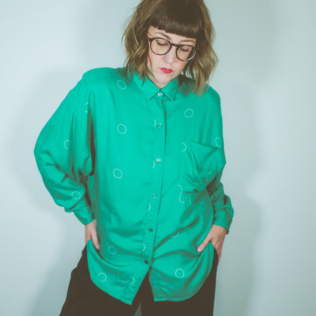 Second Room Vintage Clothing. Vintage green long sleeve button up with white circles design, one front pocket, and shoulder pads, which could be easily removed if desired. Free Shipping on all orders within North America.