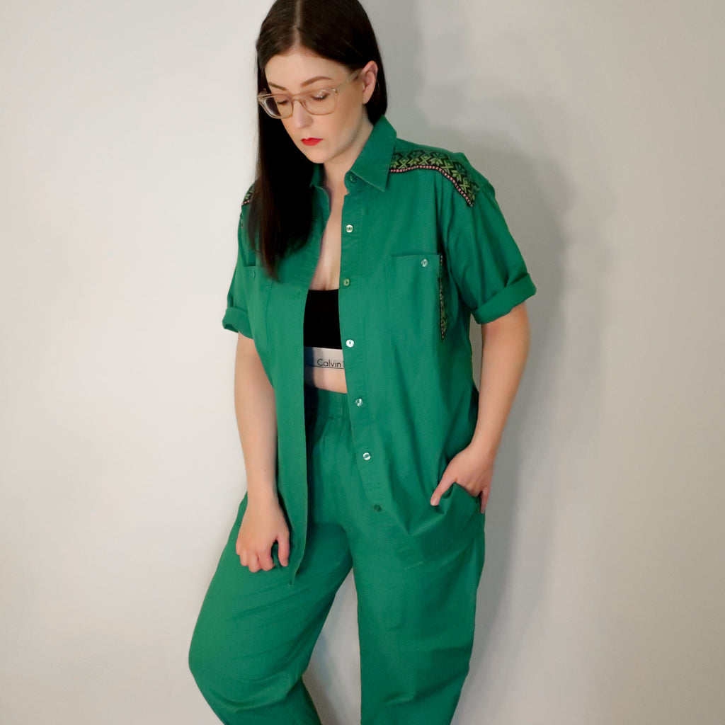 Second Room Vintage Clothing. Vintage 90s green two piece set. Shirt is short sleeved, button up, with two front pockets, and embroidered detail on shoulders and pocket. Free North American shipping on all orders.