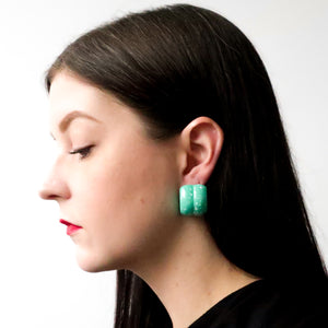 "Second Room Vintage Clothing. Vintage puffy green acrylic earrings, with white paint splatter design; 1"" wide and 1"" long. Original earring backs have been replaced with new, clear silicone backings. Free North American shipping on all orders."