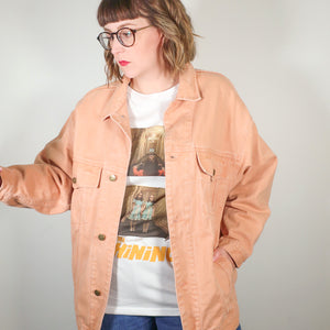 Second Room Vintage Clothing. This is the ultimate 90s jean jacket, in an amazing worn in peach color! Two breast pockets, Karuba logo buttons, and two front side pockets. This jacket is unreal! Free Shipping on all North American orders.