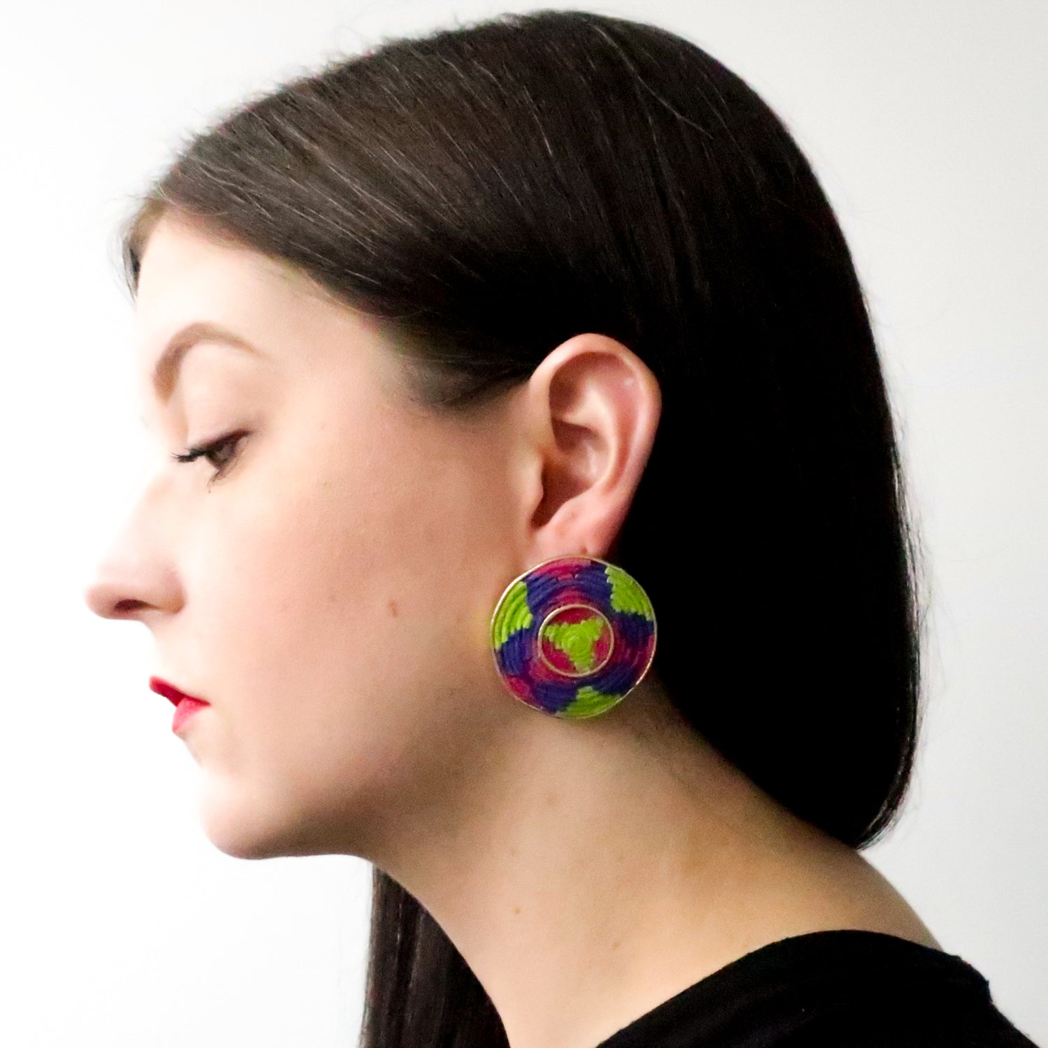 Second Room Vintage Clothing. These earrings are handmade out of suede leather, with an inset design in bright neon pink, purple and lime green. Free North American shipping on all orders.