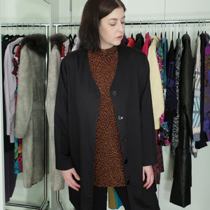 Second Room Vintage Clothing. Vintage minimalist, oversize black cardigan style jacket, with v neck, buttons down the front and long sleeves. Free North American shipping on all orders.