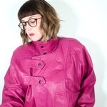 Second Room Vintage Clothing. Vintage bright pink leather jacket, fully lined with two pockets, zipper front and unique collar design with snap closure. Oversize fit, with subtle sewn in shoulder pads. Union Made (ILGWU), in Canada. Free North American shipping on all orders.
