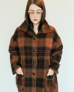 Second Room Vintage Clothing. Vintage brown, black and burgundy plaid wool blend jacket, with standing collar, two front pockets with fringe detail, buttons for closure, and a great oversize fit. Free Shipping on all orders within North America.