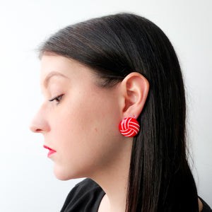 "Second Room Shop Vintage. Shop vintage, shop sustainable. Vintage acrylic red and white earrings, just under 1"" in diameter; post is at top of earring. Original earring backs have been replaced with new, clear silicone backs. Free North American shipping on this item."