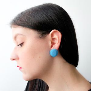 "Second Room Shop Vintage. Shop vintage, shop sustainable. Vintage acrylic blue earrings, just under 1"" in diameter, post is in the center of the earring. Original earring backs have been replaced with new, clear silicone backings. Free North American shipping on this item."