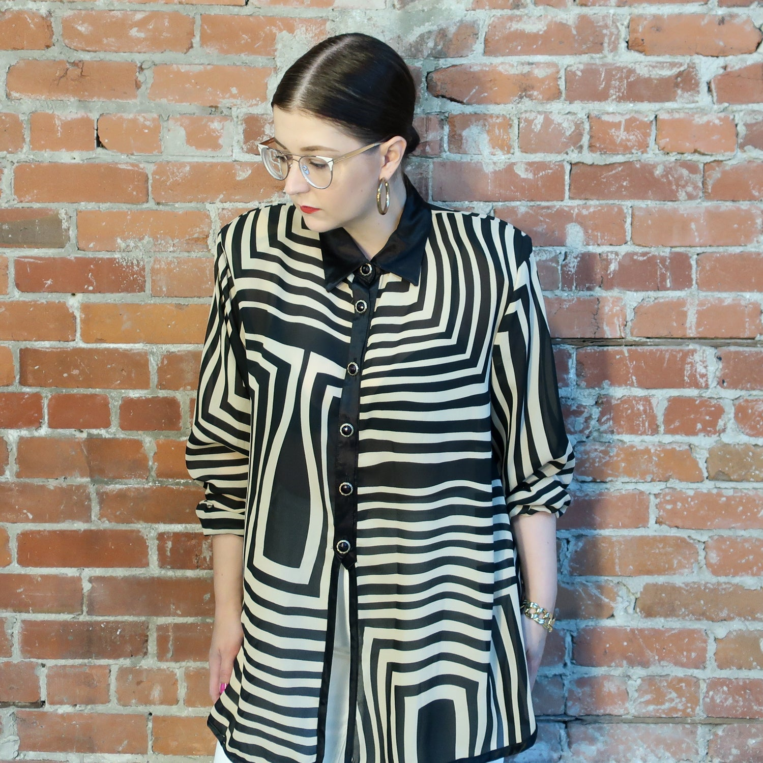 "Second Room Vintage Clothing. Vintage long sleeve tunic style blouse, semi sheer, with beige and black striped patterns. Black satin trim on collar, front, and cuffs, and has silver and black buttons that go 20"" down the front; the bottom portion of the top is open. Free North American shipping on all orders."