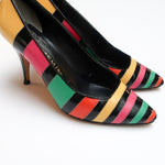 Second Room Vintage Clothing. Vintage black leather pumps with neon yellow, pink, green and orange stripes. The black leather has a bit of a patent shine, while all the stripes are a matte finish. These have an almond toe, 100% leather upper and man made sole. Free North American shipping on all orders.