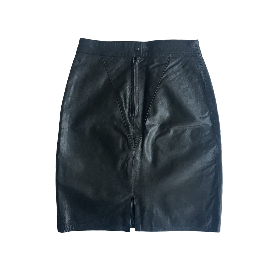 "Second Room Shop Vintage. Shop vintage, shop sustainable. This lovely vintage black leather skirt is fully lined, with 6"" back zipper, snap closure, and a slit in the back."