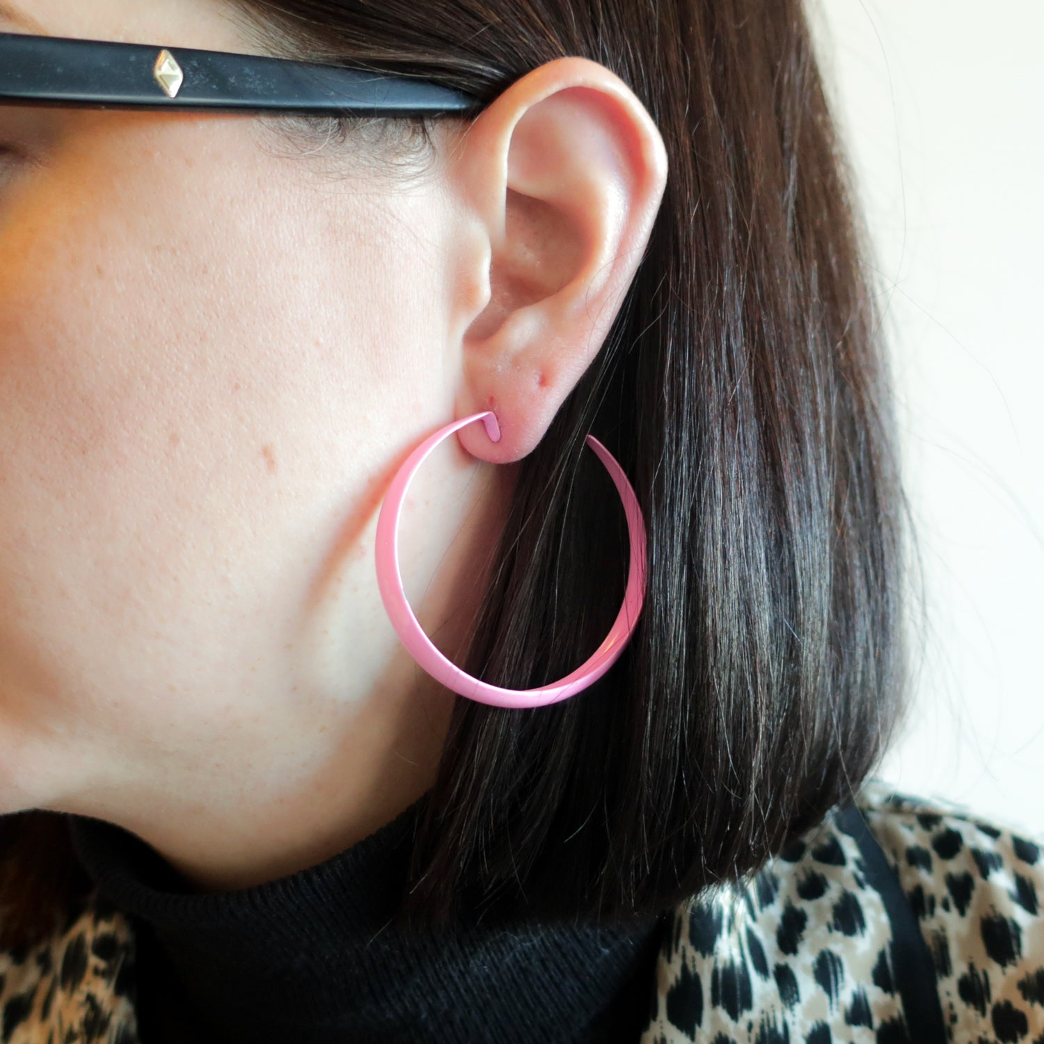 "Second Room Vintage Clothing. Vintage bubblegum pink metal painted enamel open hoop earrings, 2"" across. These have one minor chip one one edge, which is hardly noticeable, but you can see it in the photos. Original earring backs have been replaced with new silicone backs. Free North American shipping on all orders."