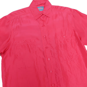 Second Room Vintage Clothing. Vintage bright pink silk short sleeve blouse, with two front pockets with buttons. Hand washable. Free North American shipping on all orders.