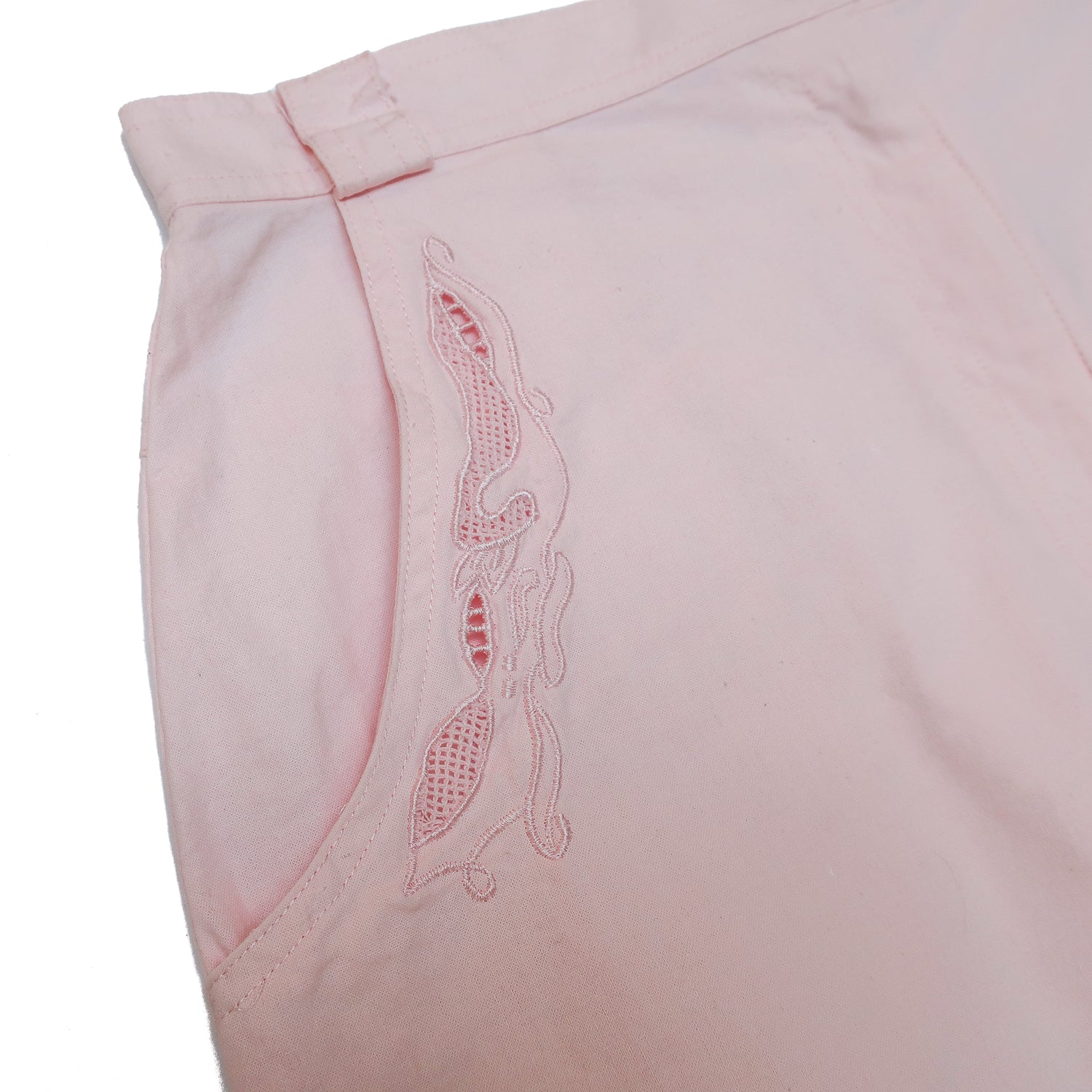Second Room Vintage Clothing. Vintage pale baby pink knee length skirt, with embroidered detail and pockets. Skirt is 100% cotton, and very lightweight. Has belt loops, back slit with 3 buttons, and a zipper and button fly front closure. Free North American shipping on all orders.