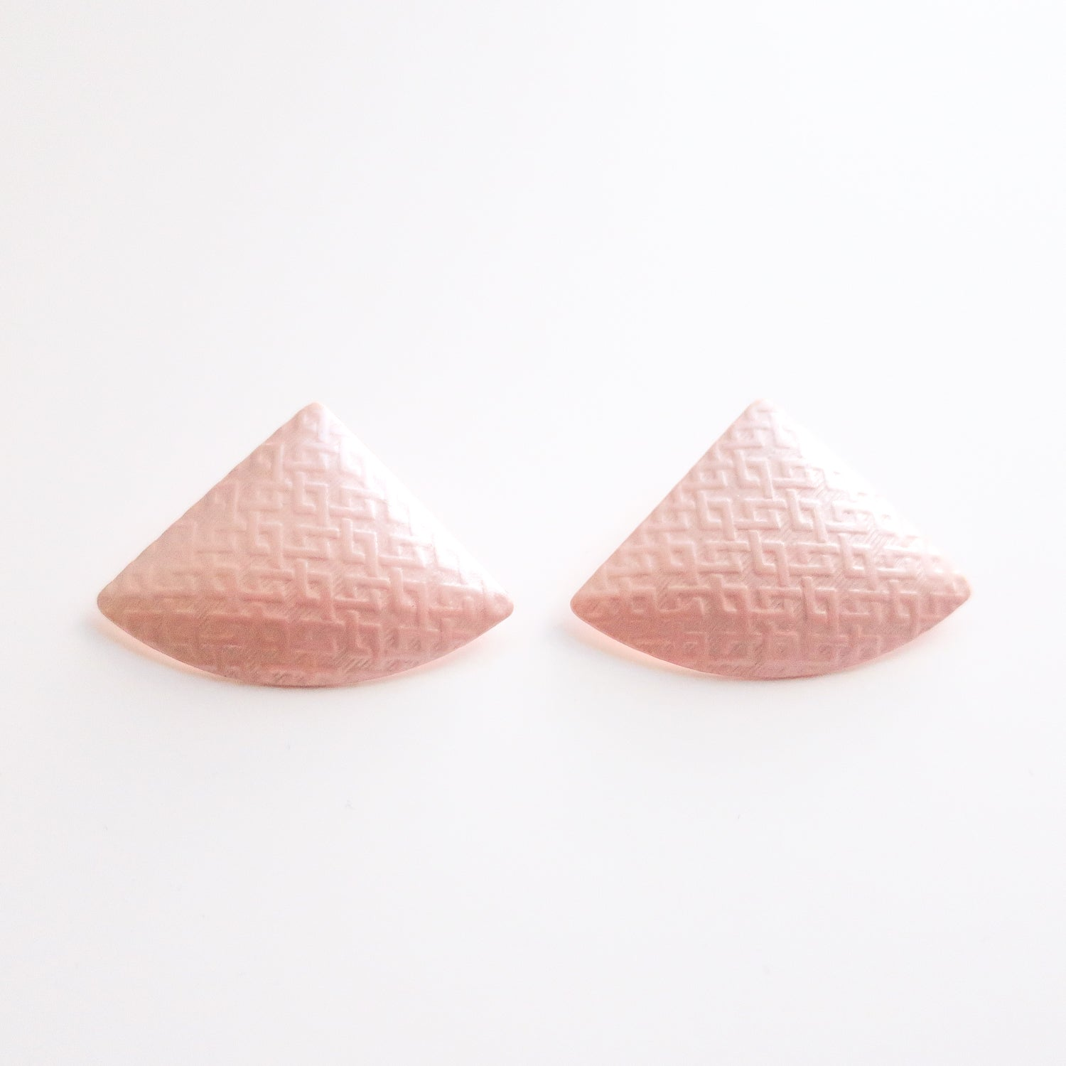 "Second Room Vintage Clothing. Vintage pale pink triangle/fan shaped enamel earrings, with subtle embossed geometric design. Earrings are 1.5"" wide and 1.25"" tall. Original earring backs have been replaced with new, clear silicone backs. Free North American shipping on all orders."