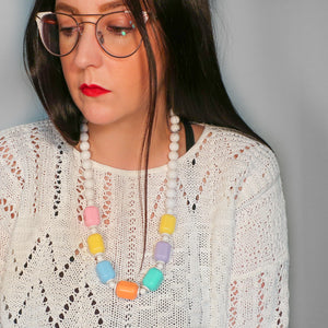 "Second Room Shop Vintage. Shop vintage, shop sustainable. Vintage plastic colourful beaded necklace, with oversize rectangular beads, in pastel pink, yellow, blue, purple and orange. Hanging length is 13"", total length is 26.5"". It has a clasp closure at the back, but is also large enough to just slip over your head."