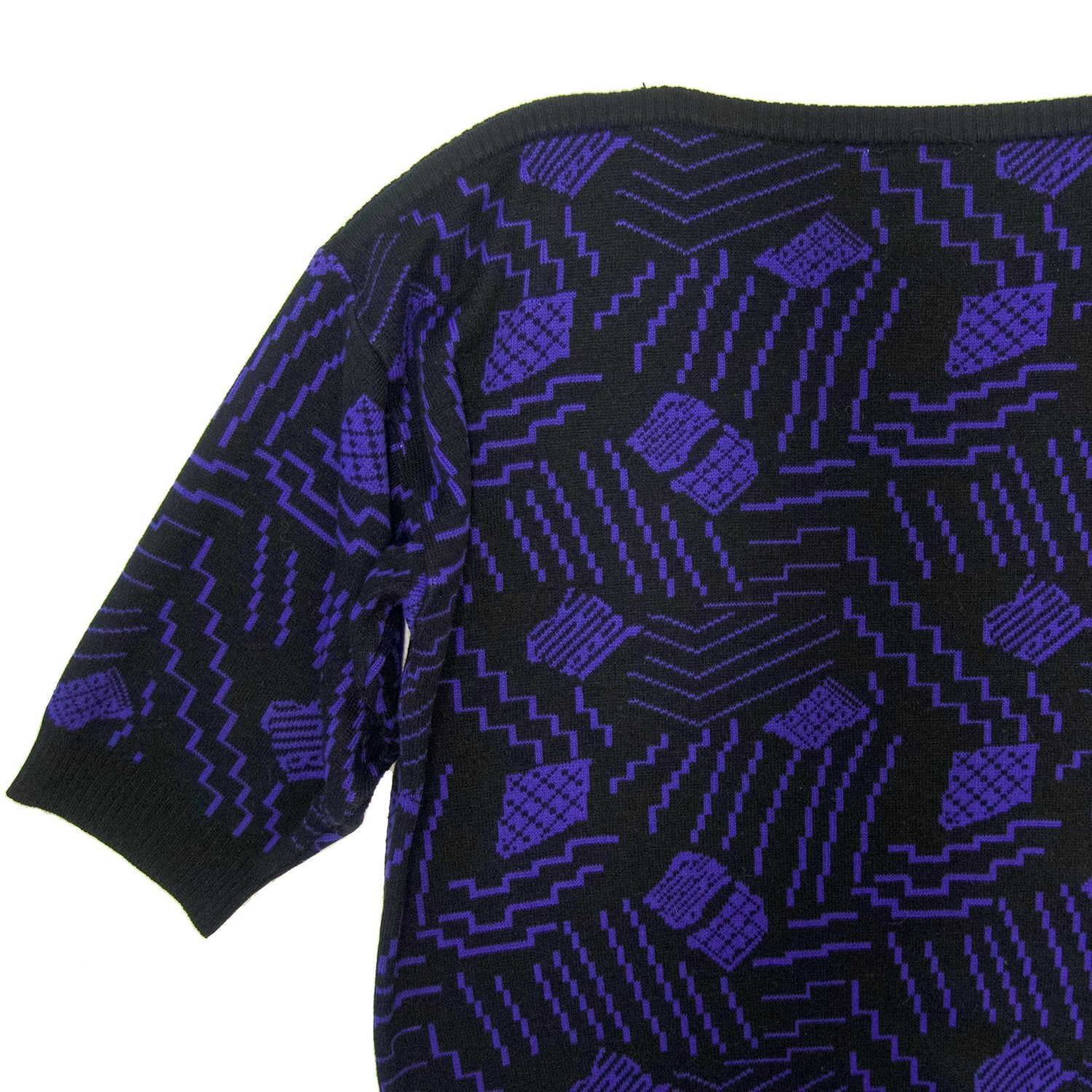 Second Room Vintage Clothing. Vintage boat neck sweater with black and purple geometric design, with 3/4 sleeve and ribbing at cuffs and waist. Free North American shipping on all orders.