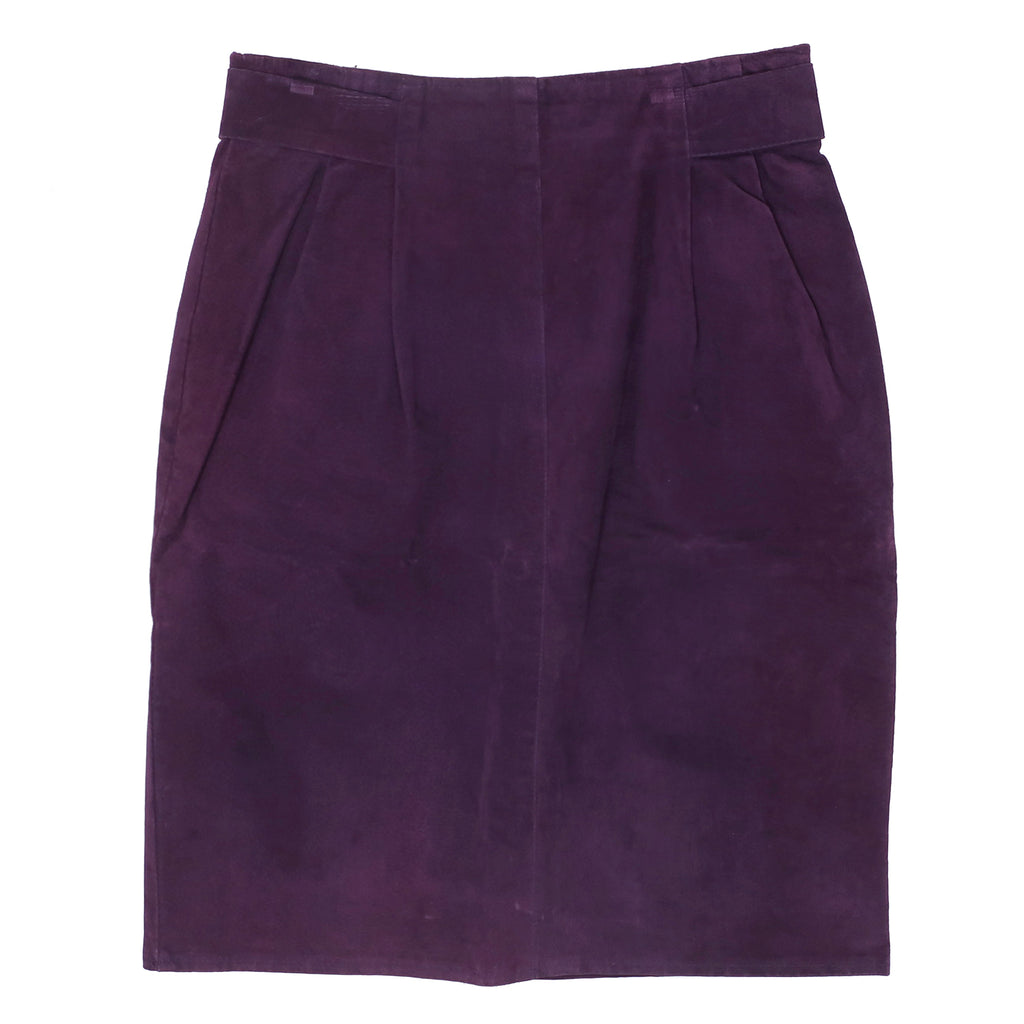 Second Room Vintage Clothing. Vintage deep purple high waist, above the knee suede skirt. Fully lined with pleating details at the front waist, with a wrap around decorative tab detail, with matte gold tone buttons at the back. Free North American shipping on all orders.