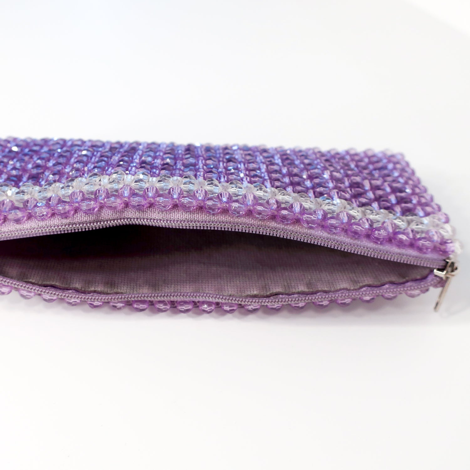 Second Room Vintage Clothing. This super cute purple and clear acrylic beaded pouch would make a great wallet, or coin purse, or could even store a few lipsticks. It has a zipper closure, and just one main interior compartment. Free North American shipping on all orders.