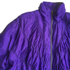 Second Room Shop Vintage. Shop vintage, shop sustainable. Vintage purple silk bomber jacket, with zipper front, gathered seaming details, and two front pockets. Has ribbed cuffs and waist, and is fully lined, with shoulder pads for shape.
