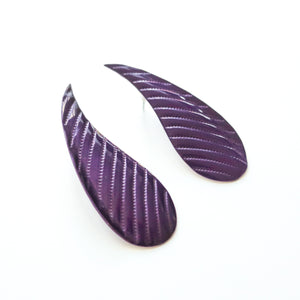 "Second Room Vintage Clothing. Vintage purple enamel tear drop shape earrings with embossed lines. Earrings are 3/4"" wide at the bottom, and 1.75"" long. Free North American shipping on all orders."